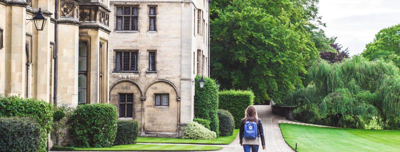 college savings plan: student walking on campus