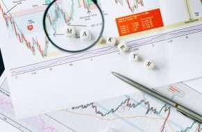 DIY Investor looking over market charts